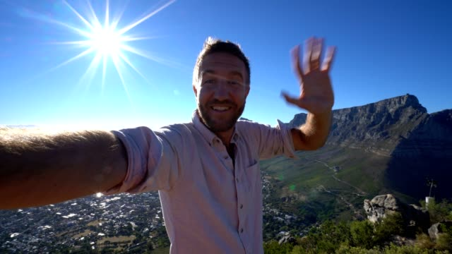 Young man taking selfie portrait in Cape Town Young man taking selfie portrait in Cape Town cape peninsula stock videos & royalty-free footage