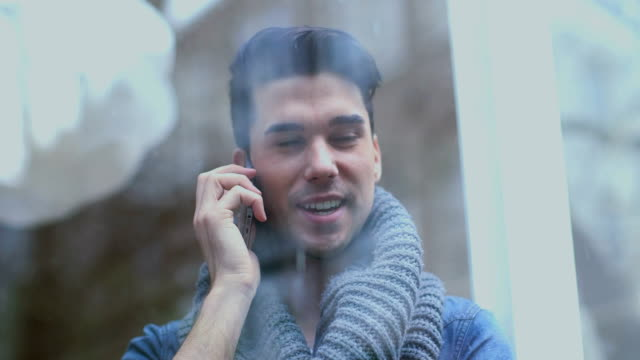 CU Young man talking on phone and smiling video