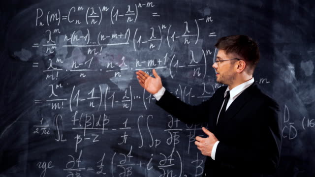 Young man teacher or student explaining decision of hard math equation video