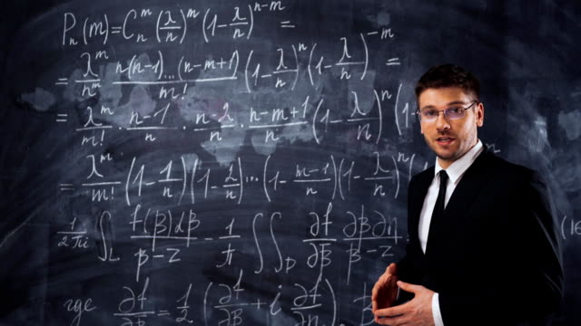 Young man teacher or student explaining decision of hard mathematic equation video