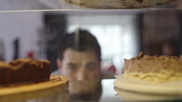 Young Man Tempted by Sweet Food video