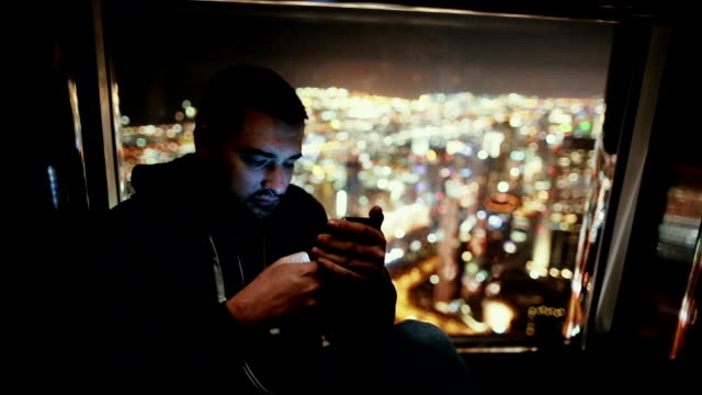 Young man texting on the phone video