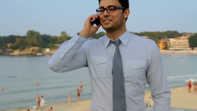 Young Man Tie Talking on Phone Beach Vacation Concept HD video