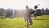 istock SLO MO Young man training his dog catching a ball 519875920