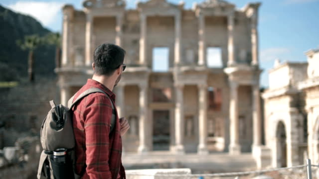 Young man travels in Ephesus ancient city Selcuk Izmir Turkey. video