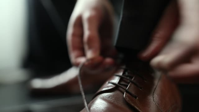 Young man tying shoe laces close-up Young man tying shoe laces close-up shoe stock videos & royalty-free footage
