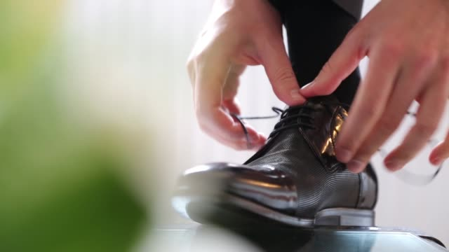 Young Man Tying Shoelaces and Preparing For Wedding video