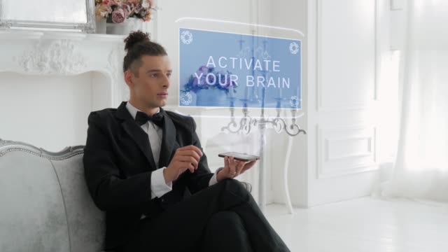 Young man uses hologram Activate your brain