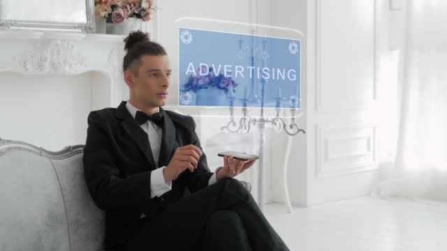 Young man uses hologram Advertising