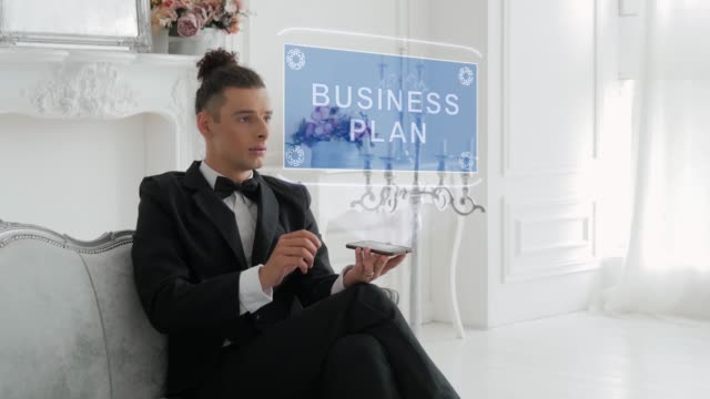 Young man uses hologram Business plan