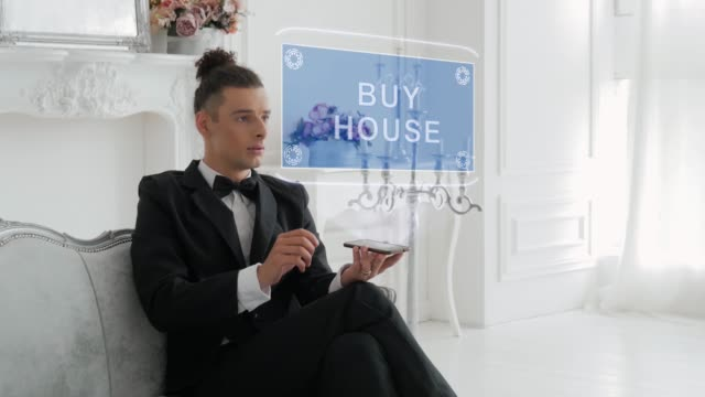 Young man uses hologram Buy house