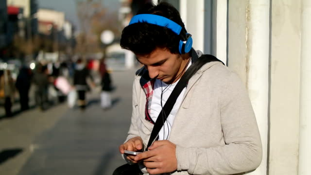 Young man using a telephone video