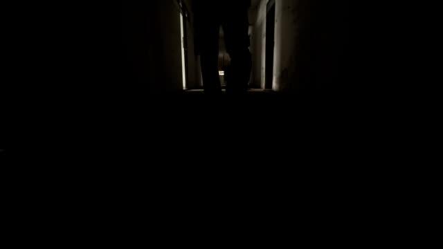 Young man walking inside an abandoned building