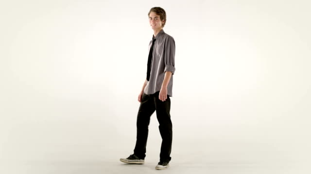 young man walking towards camera, his clothes changing - preppy fashion stock videos and b-roll footage