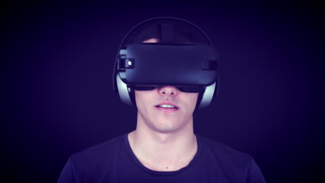 Young Man Wearing VR Headset And Playing Virtual Reality Games video