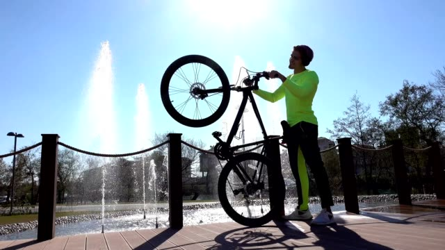 Young man wit bike exercise in the park video