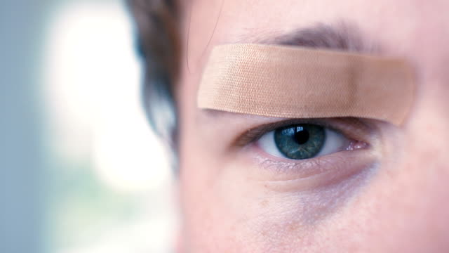 Young Man with Bandaid over Eye video