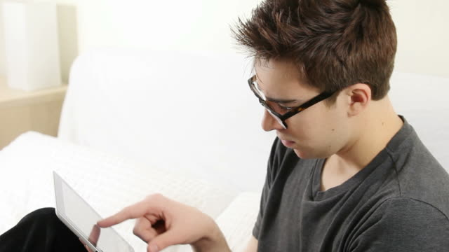 Young man with digital tablet. video