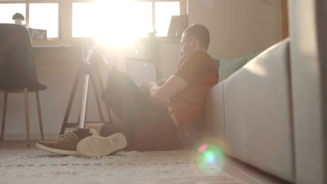 Young Man With Disability Using Laptop at Home video
