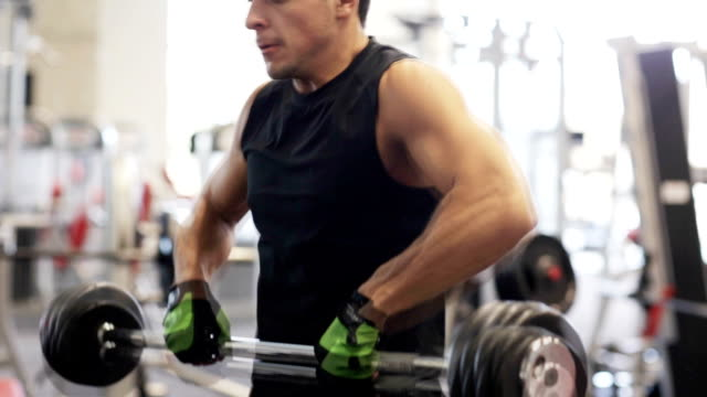 young man with dumbbell in gym video