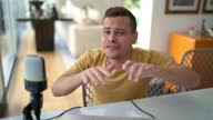 istock Young man with dwarfism vlogging at home - Webcam point of view 1311695354