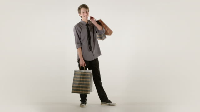 Young man with shopping bags video