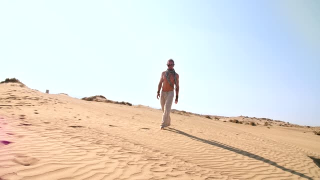 young man with steampunk goggles walking alone in desert - steampunk fashion stock videos and b-roll footage