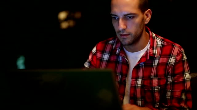 Young man working at home on lap top video