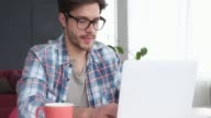 istock Young man working at home using laptop 1139882864