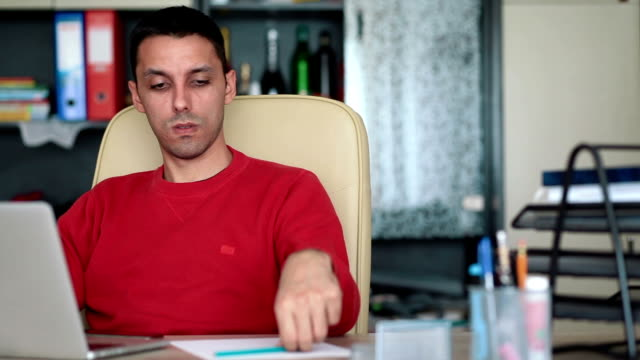 Young man working at home video