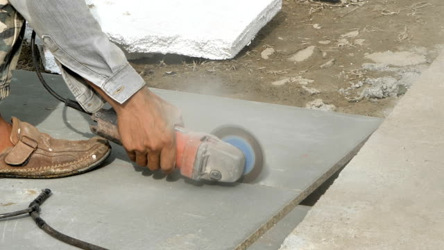 Young man working cutting wall house. Step Installation of prefabricated houses. video Slow Motion Young man working cutting wall house. Step Installation of prefabricated houses. video Slow Motion generation x stock videos & royalty-free footage