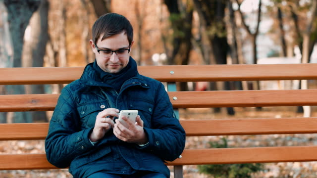 A young man working with a smartphone video