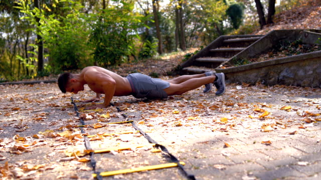 young men doing push up outdoors young men doing push up outdoors bodyweight training stock videos & royalty-free footage