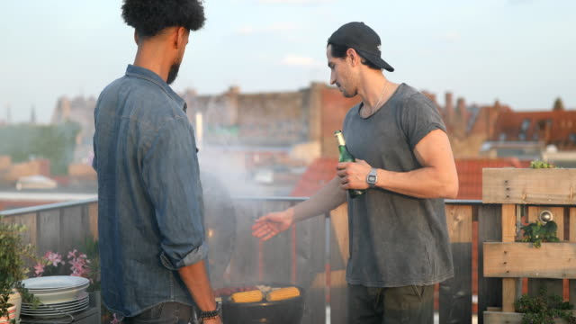 young men preparing food on barbecue grill - alla griglia video stock e b–roll