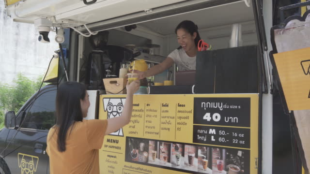 Young millennial people buying food and drink from Food Truck Young millennial people buying food and drink from Food Truck small business saturday stock videos & royalty-free footage