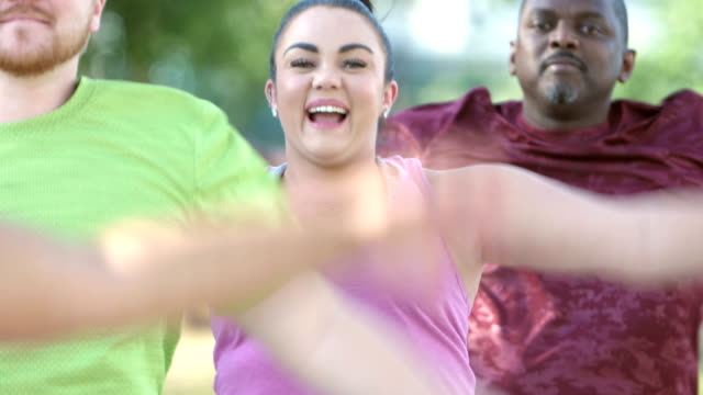 young mixed race hispanic woman in exercise class - body positive video stock e b–roll