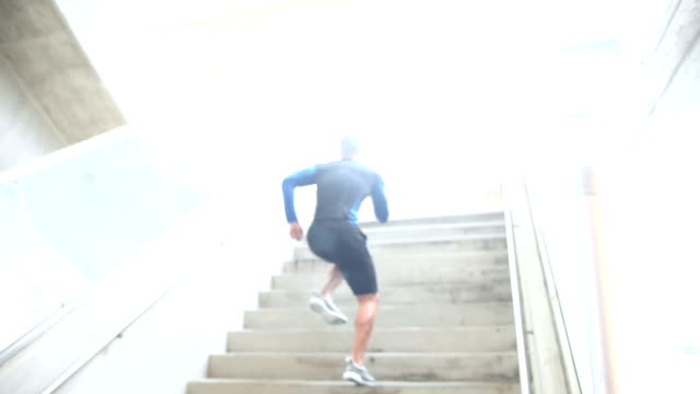 Young mixed race man, athlete training for event video