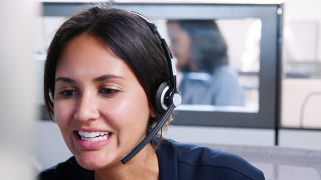 young mixed race woman working in call centre - obsługa filmów i materiałów b-roll