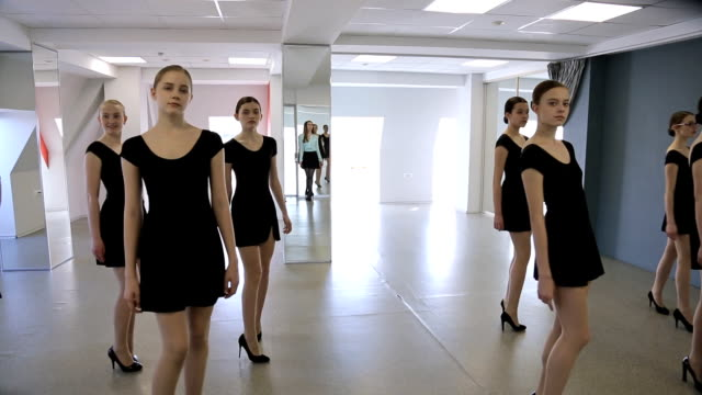Young models make rehearsal of defile in classroom video
