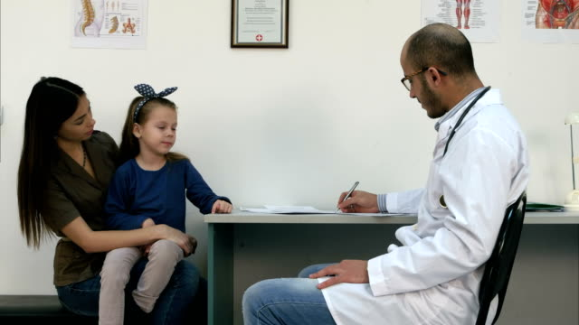 Young mother and her cute little girl at the pediatrician video
