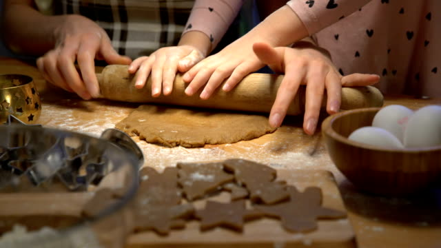 Young mother and her little daughter prepare Christmas cookies video
