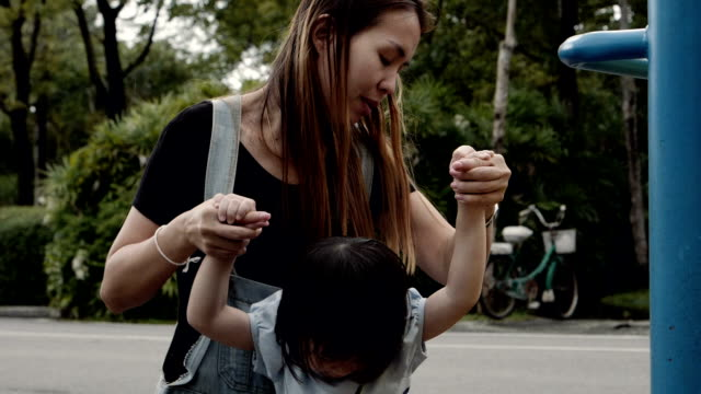 Young Mother And Little Girl At the Playground video