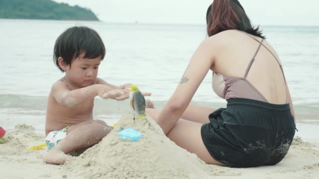 Young mother and son on beach