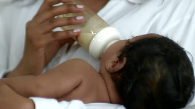 Young Mother Feeding Her Baby With A Bottle Hungry feeding stock videos & royalty-free footage