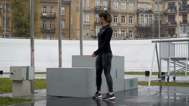 Young motivated woman at athletics podium in the stadium video
