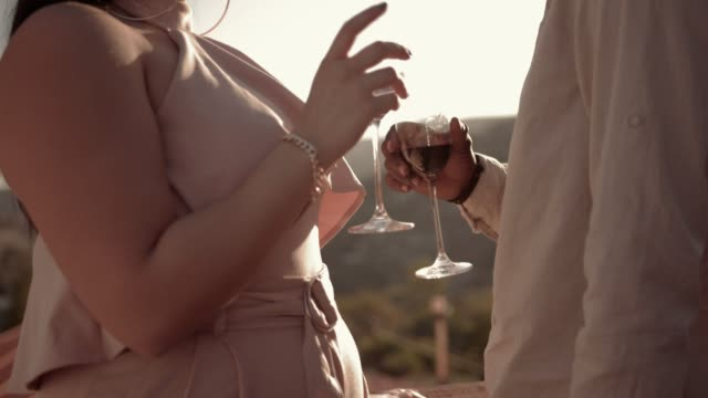 Young multi-ethnic couple drinking wine on mediterranean countryside house patio video