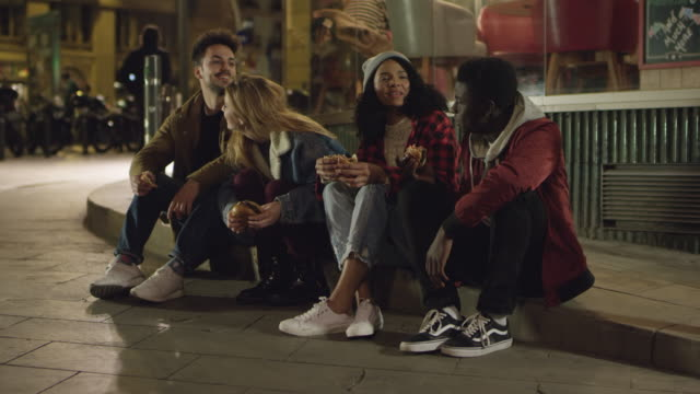 Young multi-ethnic friends enjoying nightlife video