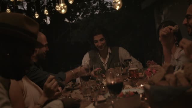 Young multi-ethnic friends having fun at mediterranean dinner party video