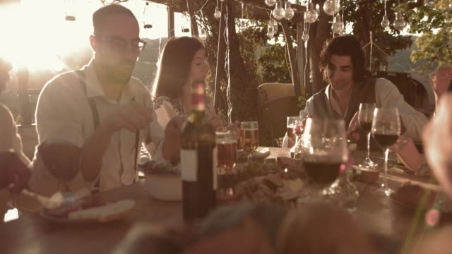 Young multi-ethnic friends having lunch at village rustic restaurant video