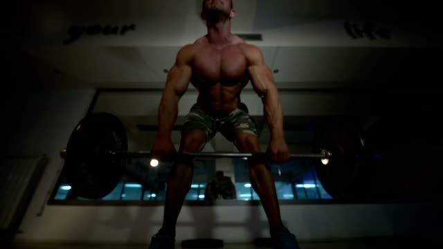 Young muscle man workout video